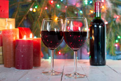 Glasses of red wine with Christmas decoration Royalty Free Stock Images