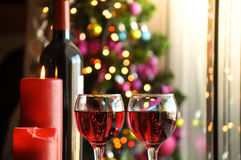 Glasses of red wine with Christmas decoration Stock Photo