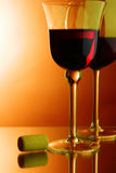 Glasses of red wine and cork Stock Images