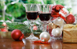 Glasses of red wine in front of Christmas tree Royalty Free Stock Image