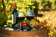 Glasses of red wine on old barrel stock image