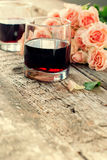 Glasses of Red Wine and Pink Roses, toned Stock Photography