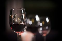 Glasses of red wine at restaurant concept alcohol royalty free stock photography