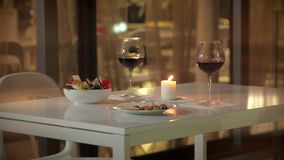 Glasses with red wine for romantic dinner for two. Evening dinner for couple. Glasses with red wine for romantic dinner for two. Two glasses of wine for dinner stock footage