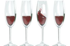 Glasses, red wine splash Stock Images
