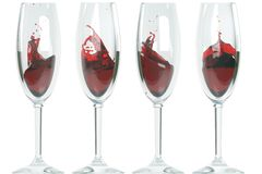 Glasses, red wine splash Royalty Free Stock Image