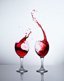 Glasses with red wine and sprays. Two glasses with red wine and sprays Royalty Free Stock Image