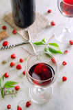 Glasses of red wine on table with strawberries Royalty Free Stock Images