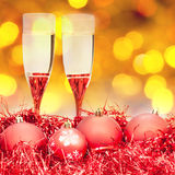 Glasses, red Xmass balls on blurry background Royalty Free Stock Images