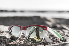 Glasses. The reflection of the holiday and relaxation Stock Photos