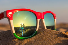 Glasses. The reflection of the holiday and relaxation Stock Images