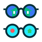 Glasses with the reflection. Glasses with reflection of the house and abstract symbols Royalty Free Stock Photos