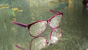 Wet glasses on wet ground stock photography