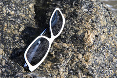 Glasses Reflections. Reflections in sunglasses on rock Stock Photos