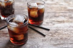 Glasses of refreshing cola with ice Stock Photos