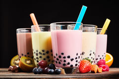 Glasses of refreshing milky boba or bubble tea Stock Photos