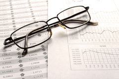Glasses on the report Stock Photography