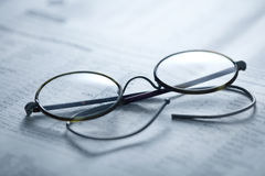 Glasses on report Royalty Free Stock Image