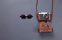 Glasses and retro camera Royalty Free Stock Photo