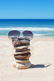 Glasses on rocks on the beach. Royalty Free Stock Photo