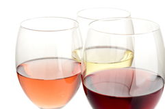 Glasses of rose, white and red wine. Rose, white and red wine in glasses on white background Stock Photography