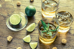 Glasses of rum on the wooden background Stock Photo
