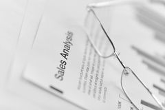 Glasses on sales report document. Glasses on sales analysis document Stock Images