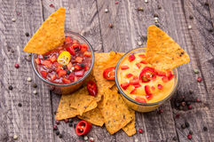 Glasses with Salsa- and Cheese Sauce Stock Image