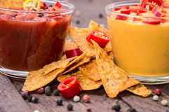 Glasses with Salsa- and Cheese Sauce Royalty Free Stock Images