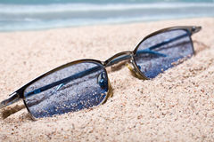 Glasses in sand Stock Photography