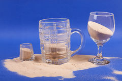 Glasses with sand Stock Images