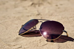 Glasses on the sand. Near the river Royalty Free Stock Image