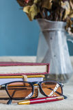 Glasses and school supplies Stock Image