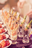 Glasses with seafood snacks, toned image Royalty Free Stock Images