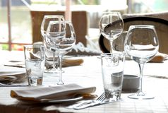 Glasses served on table in restaurant Royalty Free Stock Photos