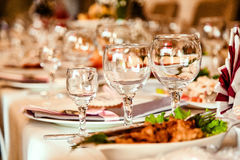 Glasses on a serving table Royalty Free Stock Photography