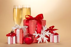 Glasses, set of gift boxes and snowflake Stock Photos