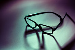 Glasses and shadow Royalty Free Stock Images