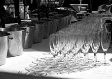 Glasses in shadow. Wine glasses in readiness for wedding reception Stock Images