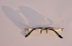 Glasses with shadow. Light and shadow in the shape of the object,Thailand royalty free stock photo