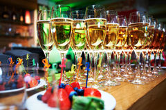 Glasses of shampagne and berry deserts Stock Images