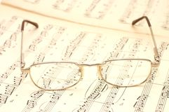 Glasses on sheet music Royalty Free Stock Images