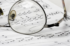 Glasses on sheet music. Close up photo of glasses on sheet music Stock Photos