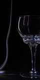Glasses silhouettes drinking glass on a black background illumin Royalty Free Stock Image