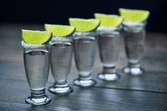 Glasses of silver  tequila with lime,selective focus Royalty Free Stock Photo
