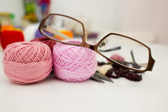 Glasses with skeins of yarn Stock Photography
