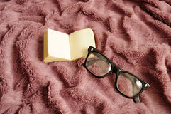 Glasses and a small book Stock Photography