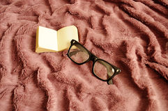 Glasses and a small book Royalty Free Stock Photos
