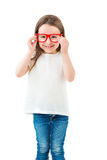 Glasses and small girl. Casual trendy hipster child. Clothes for placing your own information logo or images. Holding glasses frame. Smiling lovely child. White stock photography