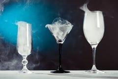 Glasses with smoke Stock Image